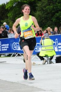 Clare finishing her marathon